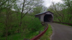 Aerial of Covered Bridge, Creek, and Road in Rural Area Stock Footage