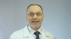 Excitement on happy face of male doctor surprised by good career opportunity - stock footage
