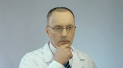 Serious face of male therapist or scientist thinking hard about complex problem - stock footage