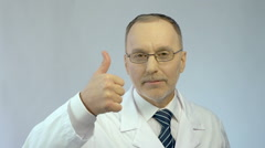Professional therapist looking confidently at camera, making thumbs-up gesture Stock Footage