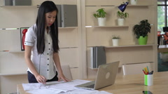 Woman working with blueprint architectural sketch and checking details Stock Footage