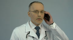 Doctor calling patient, medical consultation service by phone, health care Stock Footage