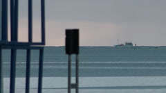Boat sails by in Suva, Fiji, clear sky, ocean coastline, horizon HD Video - stock footage