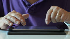 Old Hands of the Elderly Person Write an Email to Tablet - stock footage