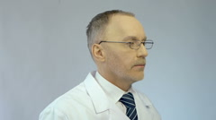 Experienced chief physician turning face to camera, high quality medical care Stock Footage