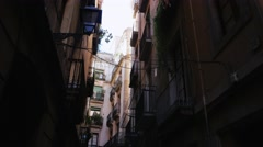 Steadicam shot: Old houses in the Gothic Quarter of Barcelona Stock Footage