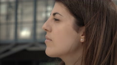 Pensive sad woman in the city, side closeup portrait Stock Footage