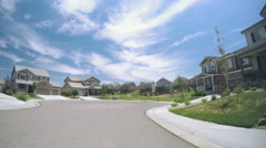 Car driving through residential neighborhood in Suburbia.-POV point of view. Stock Footage