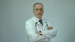 Professional doctor looking at camera, high quality medical services at hospital Stock Footage