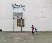 Group of kids playing basketball - stock photo