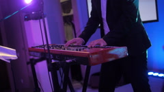 Hands of musician playing keyboard in concert with shallow depth of field Stock Footage