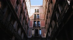 Steadicam shot: Old house with balconies in Barcelona's Gothic Quarter Stock Footage