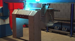 Robotic welding arm welds metal construction in steel plant metal and iron Stock Footage