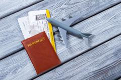 Passport near toy plane. Stock Photos