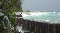 Funafuti, Tuvalu Coastline/Seawall, waves crashing, people far away HD Video Stock Footage