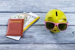 Brown passport and money box. - stock photo