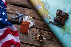Brown passport and US flag. Kuvituskuvat