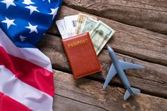 USA flag and a passport. Kuvituskuvat