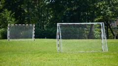 View of a net on vacant soccer pitch Stock Photos