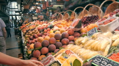 Young beautiful woman shopping in a supermarket in the department of fruit and Stock Footage
