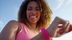 Afro hair African American female doing workout activity using wearable Stock Footage