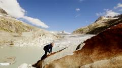 man hiking alone in mountain landscape scenery. adventures trekking climbing - stock footage