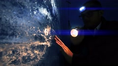 Man holding flashlight discovering ice glacier. global climate change background Stock Footage