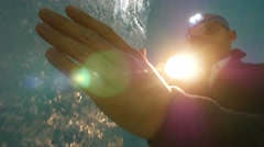 male researcher proving ice quality inside glacier cave holding flashlight - stock footage