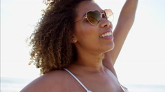 Portrait of happy afro hair Ethnic African American female by the ocean  Stock Footage