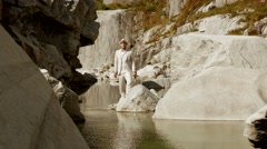 Young caucasian man in white casual suit enjoying life. recreational happiness Stock Footage