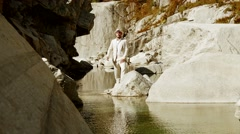 Stylish casual man in white suit enjoying peaceful nature outdoors. hats off Stock Footage