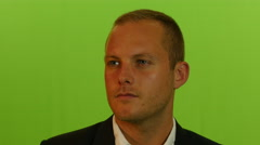 Close up of young businessman isolated against green screen background Stock Footage