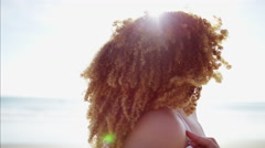 Portrait of attractive young afro hair African American female relaxed Stock Footage