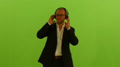 Listening to music with headphones. dance moves. man isolated green screen Stock Footage