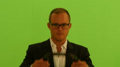man with headphones listening music and dancing against green screen background. - stock footage