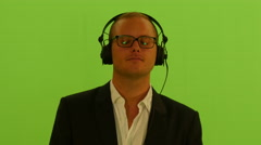 Man listening music with headphones. closed eyes. isolated green screen Stock Footage