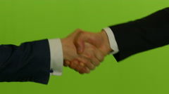 Handshaking businessman's against green screen background Stock Footage