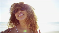 Portrait of attractive young voluptuous Ethnic African American female relaxed Stock Footage