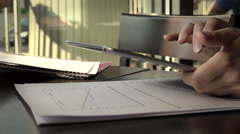 Businesswoman working with paper documents and tablet computer in a cafe Stock Footage