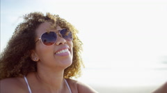 Happy voluptuous African American female in the sunshine and having fun  Stock Footage