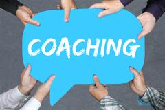 Group of people holding with hands the word coaching and mentoring education  - stock photo