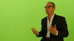 Talking businessman isolated against green screen. discussing hand gestures Arkistovideo