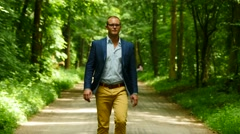 Man walking straight forward. facing camera. young male. business lifestyle Stock Footage