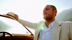 Handsome single man in casual suit enjoying life on boat ride. hats off Stock Footage