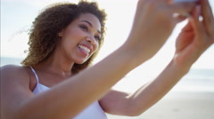 Attractive voluptuous African American female on vacation taking a selfie photo Stock Footage