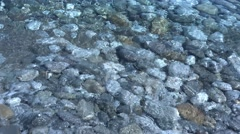 Sea waves roll on wet pebble beach 2.  4K - stock footage