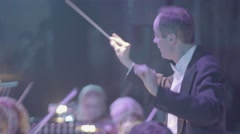 The conductor conducts an orchestra Stock Footage