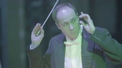 Conductor with baton in hand conducting the orchestra Stock Footage