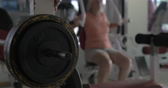 Fixing weight plate on the bar-bell Stock Footage