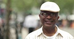 Elderly man in city face portrait smile happy Stock Footage